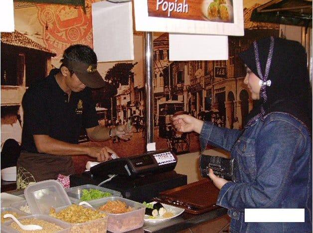 Customer paying at the cashier